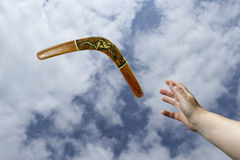 Catching returning painted boomerang Royalty Free Stock Photos