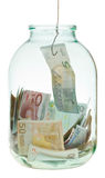 Catching saving euro money from glass jar Stock Image