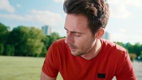 Catching a short break during running. Handheld video shows of man catching a short break during running stock footage