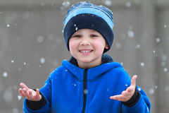 Catching snowflakes stock photography