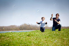 Catching soap bubbles Stock Photography