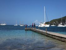 Catching sprat on a jetty in the caribbean stock footage