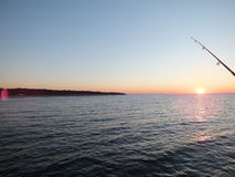 Catching the sun. Fishing at the sea stock photos
