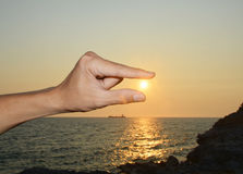 Catching sun in the man's hand Stock Photo
