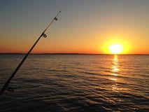 Catching a sunset. Tropical sunset fishing coastal waters orange Royalty Free Stock Photos