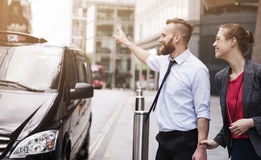 Catching taxi. Call the taxi, we can't be late on the meeting Stock Photography