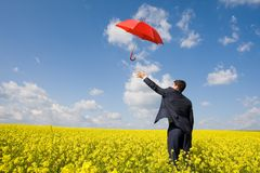 Catching umbrella Royalty Free Stock Photos