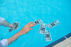 Catching wet banknotes Stock Images