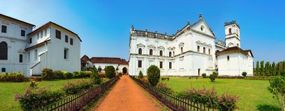 SE Cathedral in Old Goa, India. Catedral de Santa Catarina, known as SE Cathedral and Archbishop`s Palace in Old Goa, India. The view from the road to the royalty free stock images