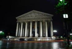 Catedral Madeleine por noche, París Foto de archivo