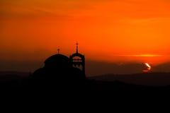 Catedral y puesta del sol Foto de archivo libre de regalías