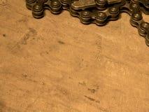 Catena della bici sulla tavola di legno Fotografia Stock Libera da Diritti