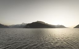 Catena montuosa delle alpi al tramonto Immagini Stock Libere da Diritti