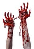 Catena sanguinosa della tenuta della mano, catena sanguinosa, tema di Halloween, fondo bianco, isolato Fotografie Stock