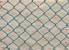 Catena senza giunte della rete fissa sulla priorità bassa della sabbia Fotografia Stock