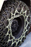 Catene di neve sulla rotella Fotografia Stock Libera da Diritti