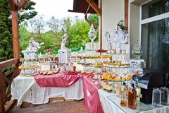 Catered table full of different snacks and fruits. Wedding banqu Stock Photography