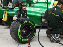 Caterham Renault doing practice of changing tyres Royalty Free Stock Photo