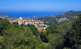 Cateri with nearby Aregno, Corsica. Mountain village of Cateri with distant Aregno above the Mediterranean, Corsica, France Royalty Free Stock Photography