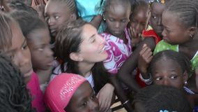Caterina Murino. MATAM,SENEGAL-CIRCA NOVEMBER 2013:Actress Caterina Murino greets the children of an elementary school,Caterina Murino is the testimonial of the