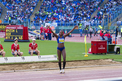 Caterine Ibargüen. Representant of Colombian at triple jump saluting the public on Diamond League in Rome, Italy in 2016 royalty free stock images