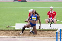 Caterine Ibargüen at triple jump. Caterine Ibargüen representant of Colombian at triple jump talking to his coach on Diamond League in Rome, Italy in 2016 stock image
