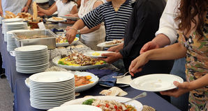 Catering. Service, people self serving on a buffet Stock Photos