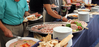 Catering. Service, people self serving on a buffet Royalty Free Stock Image