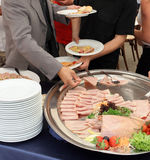 Catering. Service, people self serving on a buffet Stock Photography
