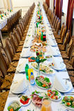 Catering. Banquet meal trays served on tables Stock Images