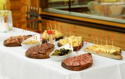 Catering, assorted meats, cheese and sausages Royalty Free Stock Image