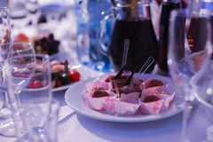Catering banquet table with baked food snacks, sandwiches, cakes, cups and plates, self serve, open buffet dinner Stock Photography