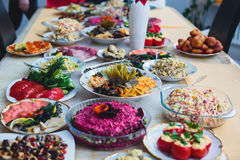Catering banquet table with different food snacks and appetizers on corporate christmas birthday party event Royalty Free Stock Photos