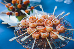 Catering banquet table with different food snacks and appetizers on corporate christmas birthday party event Stock Photography