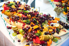 Catering banquet table with different food snacks and appetizers on corporate christmas birthday party event Royalty Free Stock Images