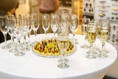 Catering Banquet table with plate of canapes and glasses stock photography