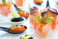 Catering banquet table with salad and caviar Stock Photos