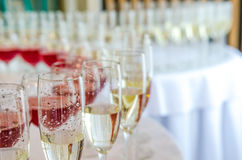 Catering bar for celebration. Beauty of interior for wedding day. Champagne in the glases on the round table Stock Image