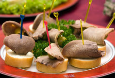 Catering - beef tongue appetizer. Catering - beef tongue with olive canape appetizer Royalty Free Stock Photography