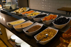 Catering breakfast. Variety of cereal and dried fruits served for breakfast, catering bar at a restaurant Stock Image