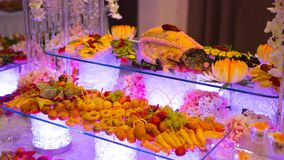 Catering buffet food indoor in luxury restaurant. People group catering buffet food indoor in luxury restaurant with meat colorful fruits and vegetables stock photos