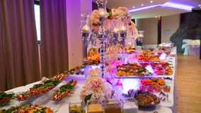 Catering buffet food indoor in luxury restaurant. People group catering buffet food indoor in luxury restaurant with meat colorful fruits and vegetables royalty free stock images