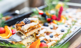 Catering buffet food outdoor. Cakes colorful fresh fruits berries oranges grapes and herb decorations Royalty Free Stock Images