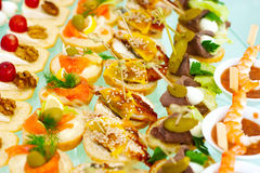 Catering buffet style with different light snack Stock Images