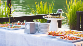 Catering buffet style with different light snack Stock Photos