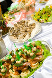 Catering buffet style - different sandwiches and p. Astry beautifully decorated on the trays Royalty Free Stock Photos