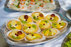 Catering buffet style - fruit cakes. Beautifully decorated on the plate Royalty Free Stock Images
