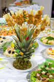 Catering buffet style - pineapple. Beautifully decorated with roasted chicken S signs on chopsticks Royalty Free Stock Photos
