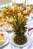Catering buffet style - pineapple. Beautifully decorated with roasted chicken S signs on chopsticks Royalty Free Stock Images