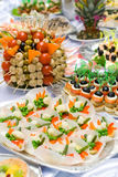 Catering buffet style - tomatoes, mushroomes and o Stock Photos